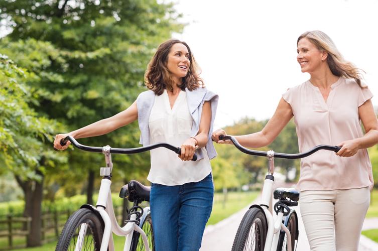 women smiling biking