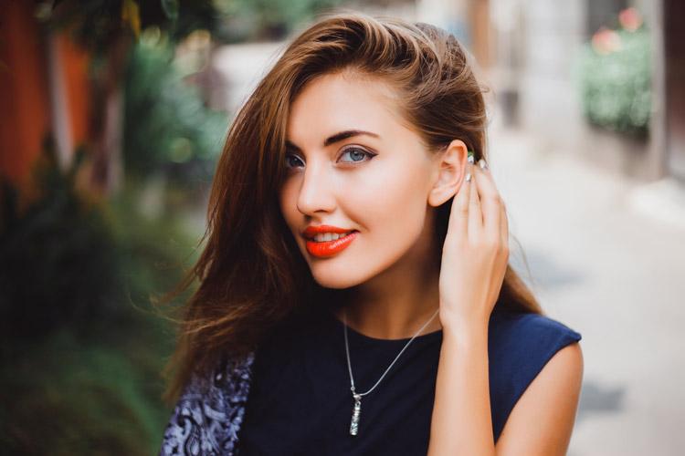 woman smiling displaying lips