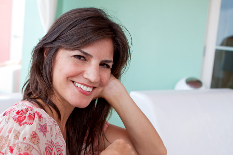 woman smiling showing flawless skin